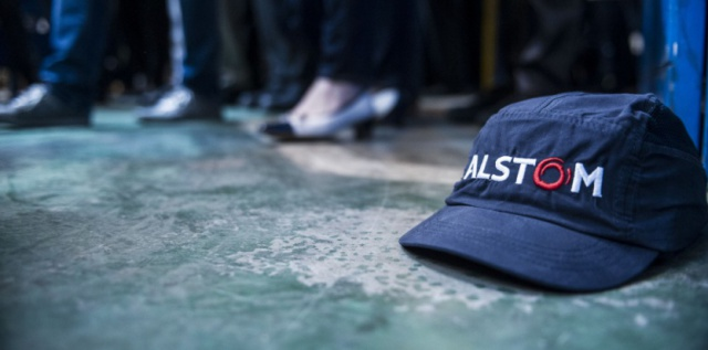 Alstom выплатит США