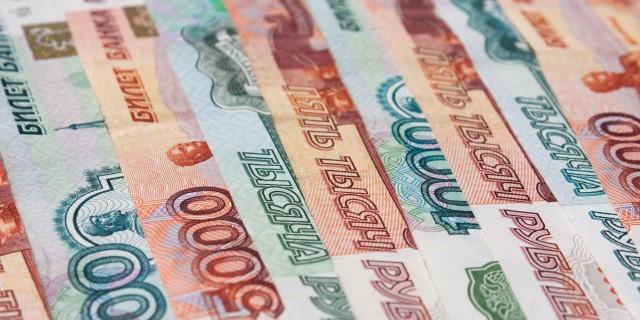 Доллар укрепился к рублю