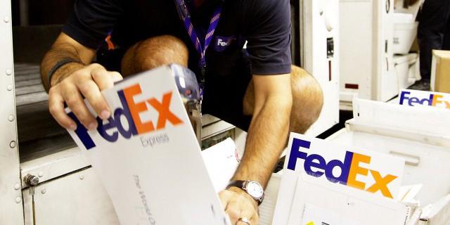 FedEx приобретает TNT