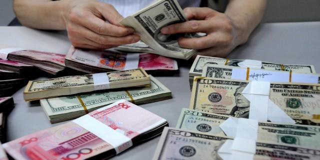 Доллар вырос к евро на